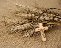 Christian cross on wheat ears - religious concept